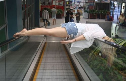 Funny Picture - One Way To Ride An Escalator